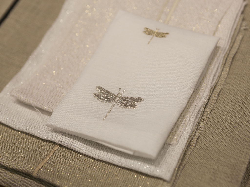 Telerie Spadari, Milan. Lurex tablecloths. Telerie Spadari, Milan. Tableware shades from yellow to cool colors of the earth and stones, and a sprinkling of Lurex weft finely embroidered in gold linen, bronze or silver.