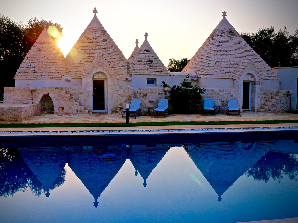 "Relais Villa Aieni. Istria. San Vito dei Normanni. The ""six cones"" at sunset. The outdoor furniture is from the Nardi, Scolaro collection."