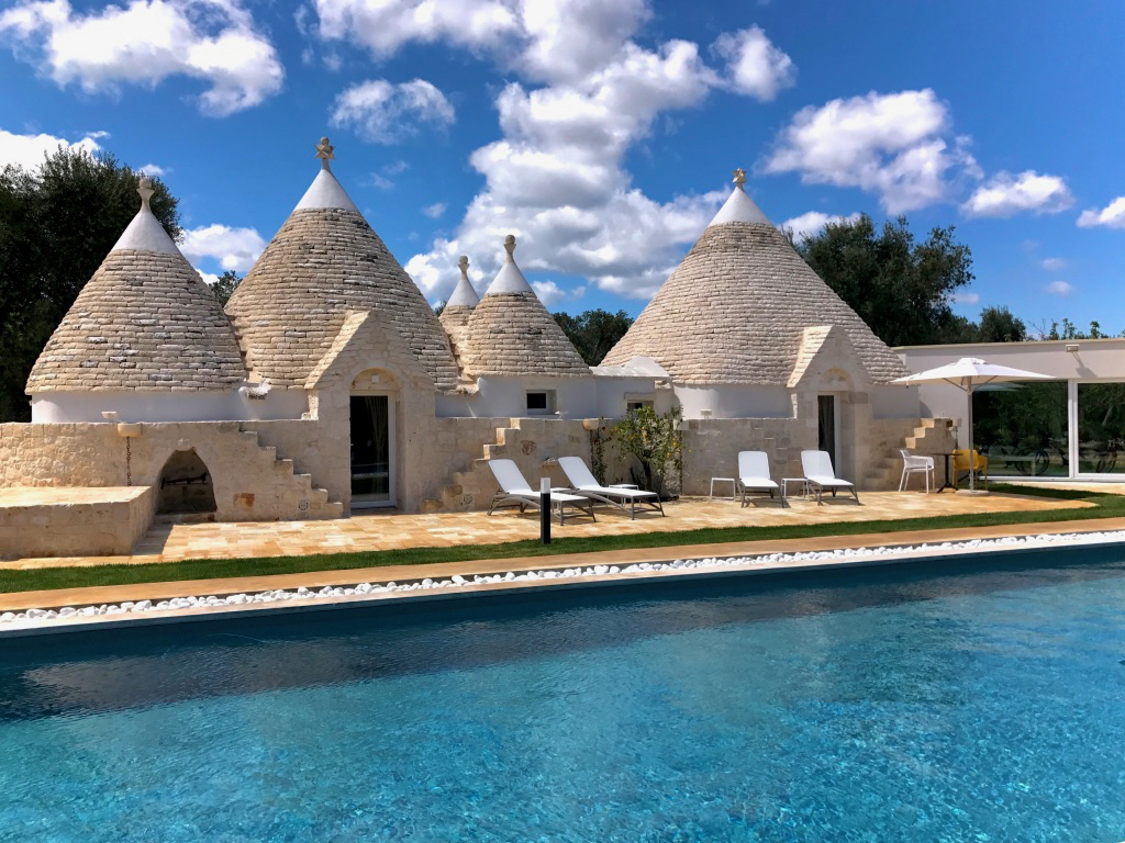 "Relais Villa Aieni. Istria. San Vito dei Normanni. The ""six cones"" that make up the old structure overlook the swimming pool, 50 feet long, ideal for those who love swimming and for children who have been reserved for a shallow area."